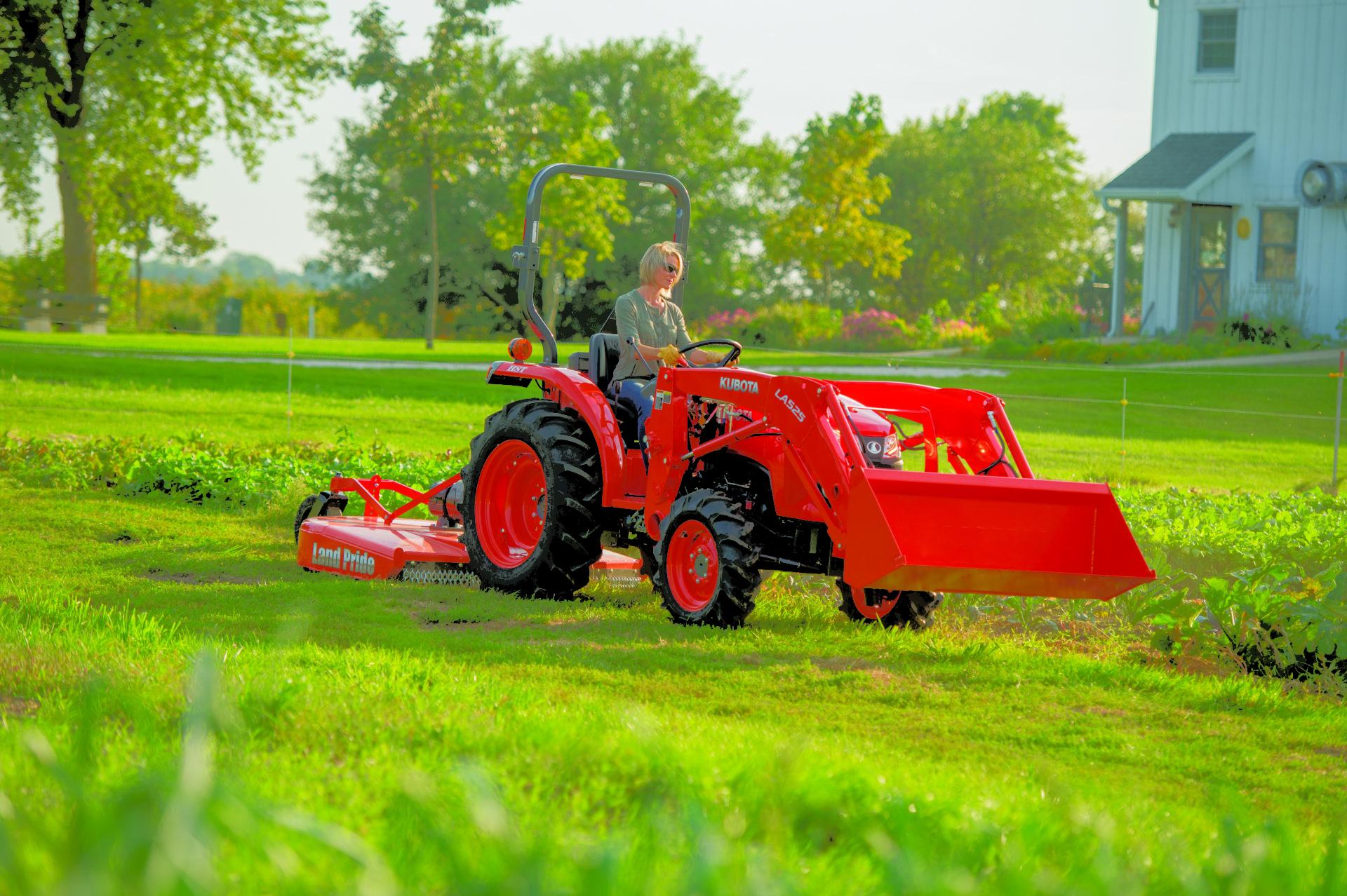 lady driving kubota tractor